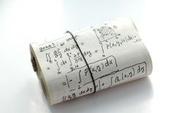 Math formulas and equations. Paper roll for cheating on exam stock photos