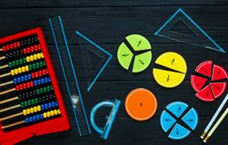 Math fractions back to school background. Colorful math fractions on wooden background or table. interesting math for kids. Education, back to school concept stock photography