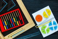 Math fractions back to school. Colorful math fractions on wooden background or table. interesting math for kids. Education, back to school concept. Geometry and royalty free stock image