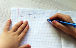 Math homework. Child Hands that makes math homework Stock Images