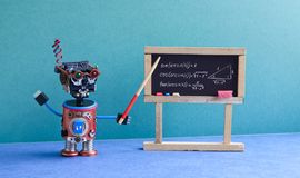 Math lesson in college. Robot teacher explains theory inverse trigonometric functions. Classroom interior with. Handwritten formula black chalkboard. Blue green Stock Images