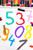 Math lesson with colorful numbers. Oil pastels drawing: math lesson with colorful numbers royalty free stock photos