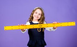 Math lesson. Education and knowledge. STEM school disciplines. Pupil girl with big ruler. small girl back to school. School student learning geometry. Math royalty free stock photography