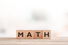 Math lesson sign on a wooden table Stock Image