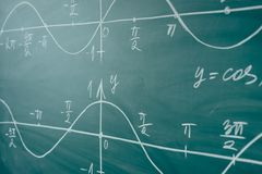Math lesson. Sine and cosine functions. Graphics graphics drawn on the Board.  stock image