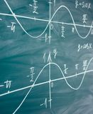 Math lesson. Sine and cosine functions. Graphics graphics drawn on the Board.  stock images