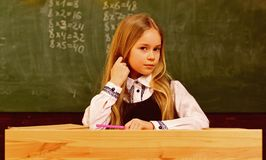Math lesson. small kid at math lesson. math lesson for cute child. math lesson at modern school. confident in her. Knowledges royalty free stock photography