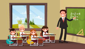 Math lesson. A teacher with pupils in primary school classroom. Vector illustration of a flat design Royalty Free Stock Photo