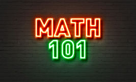 Math 101 neon sign on brick wall background. Math 101 neon sign on brick wall background Royalty Free Stock Image