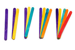 Math with popsicle sticks fanned out. Various colored popsicle craft sticks are in groups each color adds another number over white Royalty Free Stock Images