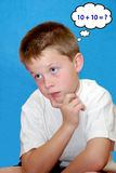 Math Problem Solving Concept. Image of a young boy in deep thought about mathematical problem solving concept royalty free stock image