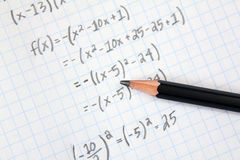 Math Problems. On graph paper with pencil royalty free stock image