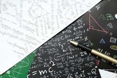 Math problems on graph paper with pencil ,formula arithmetic using for concept of World Maths Day stock photo