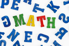 Math. Series Education - school subjects: Word Math made from colorful wooden letters royalty free stock photos
