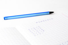 Math on a sheet of paper into a cell Royalty Free Stock Photography