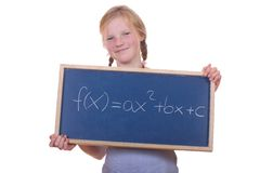 Math student. Smart young math student showing a quadratic equation royalty free stock photos