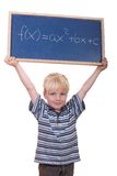Math student. Smart young math student showing a quadratic equation stock photo