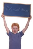 Math student. Smart young math student showing a quadratic equation stock photos