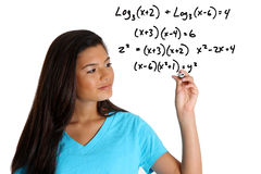 Math Student. Teen girl doing a math problem with black marker Stock Photography