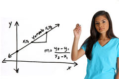 Math Student. Teen girl doing a math problem with black marker Royalty Free Stock Photos