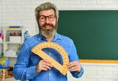 Math subject. Study mathematics. Man teacher mentoring school projects. Science modern school. Mature bearded teacher in