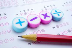 Math symbol and pencil on Answer sheet : Education study mathematics learning teach concept. Math symbol and pencil on Answer sheet background : Education study stock photography