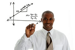 Math Teacher. Doing a math problem with black marker Stock Images