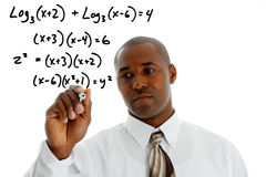 Math Teacher. Doing a math problem with black marker Royalty Free Stock Photography