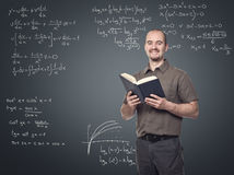 Math teacher. Portrait of young math teacher smiling stock images