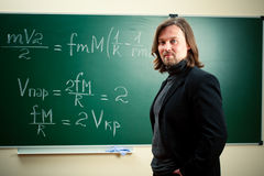 Math teacher against the blackboard Stock Photo