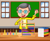Math teacher in the classroom Royalty Free Stock Photo