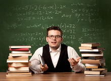 Math teacher at desk Royalty Free Stock Photography