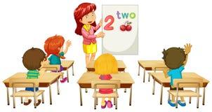 Math teacher teaching children in class Royalty Free Stock Photos
