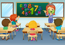 Math teacher teaching in classroom Royalty Free Stock Image