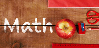 Composite image of math text on white background. Math text on white background against overhead view of apple with ruler and tablet royalty free stock photography