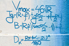 Math on the wall. Mathematical formulas written on the wall as a background stock photo