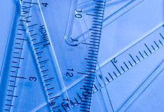 Mathematical background. Transparent rulers against a blue background (as an abstract mathematical background Royalty Free Stock Photos