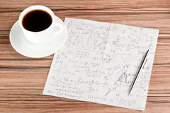 Mathematical calculations on a napkin. And cup of coffee Royalty Free Stock Photography