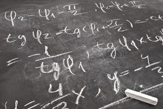 Mathematical equation. Written on chalkboard royalty free stock photo