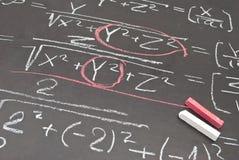 Mathematical equation. Written on chalkboard royalty free stock image