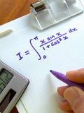 Mathematical Equation. Close-up of a clipboard on which a calculus integration equation has been written Stock Photos