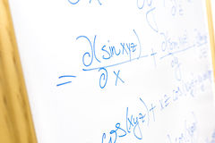 Mathematical equation. Detail of complicated mathematical equation written on whiteboard stock image