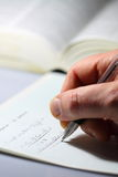 Mathematical equation man writing B. Portrait photograph of a man writing a mathematical equation stock photo