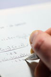 Mathematical equation man writing C. Portrait photograph of a mathematical equation being wrote down royalty free stock photography