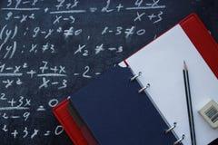 Mathematical equation and notebook stock photos