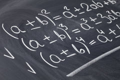 Mathematical equations on blackboard Stock Photo