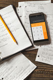 Mathematical equations written in a notebook. Calculator app. Royalty Free Stock Photo