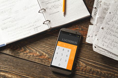 Mathematical equations written in a notebook. Calculator app. Stock Images