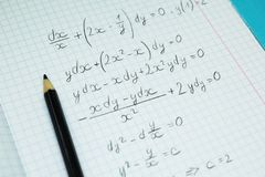 Mathematical examples and calculations in a notebook for lectures. Science and education stock images