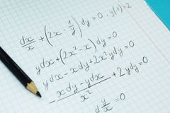 Mathematical examples and calculations in a notebook for lectures. The study of arithmetic stock image